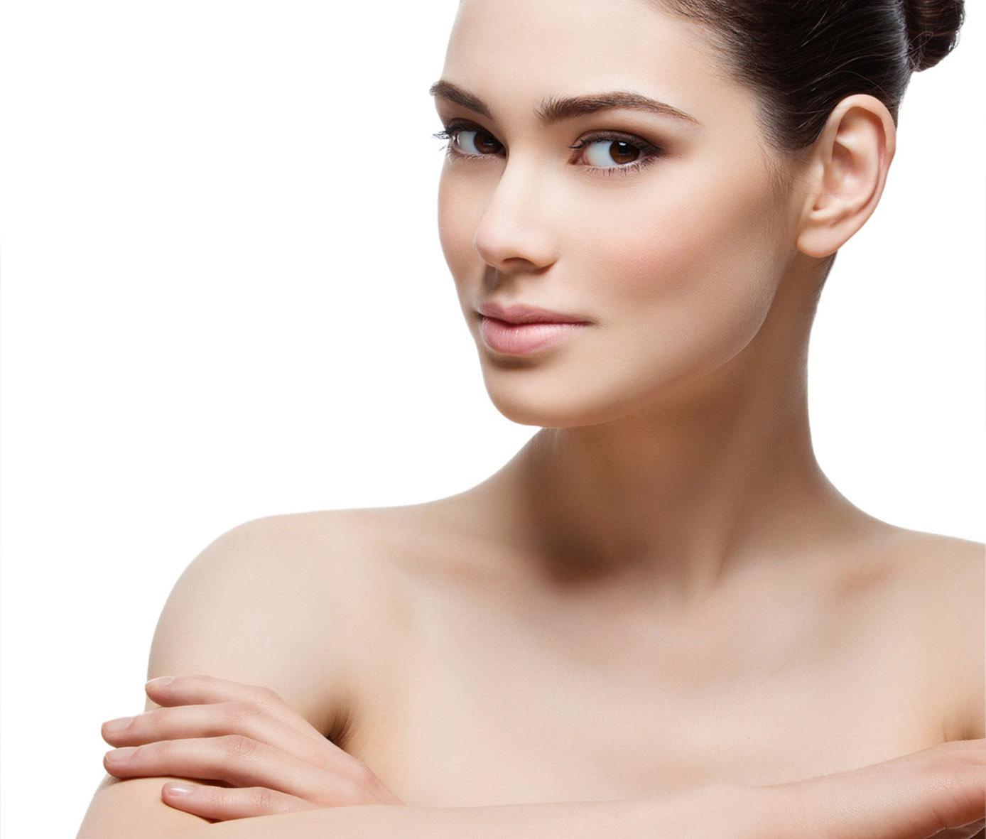 Beautiful girl applying moisturizing cream